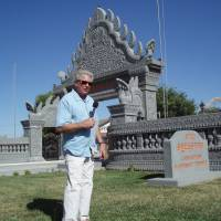 Huell howser in front of the stockton cambodian buddhist temple